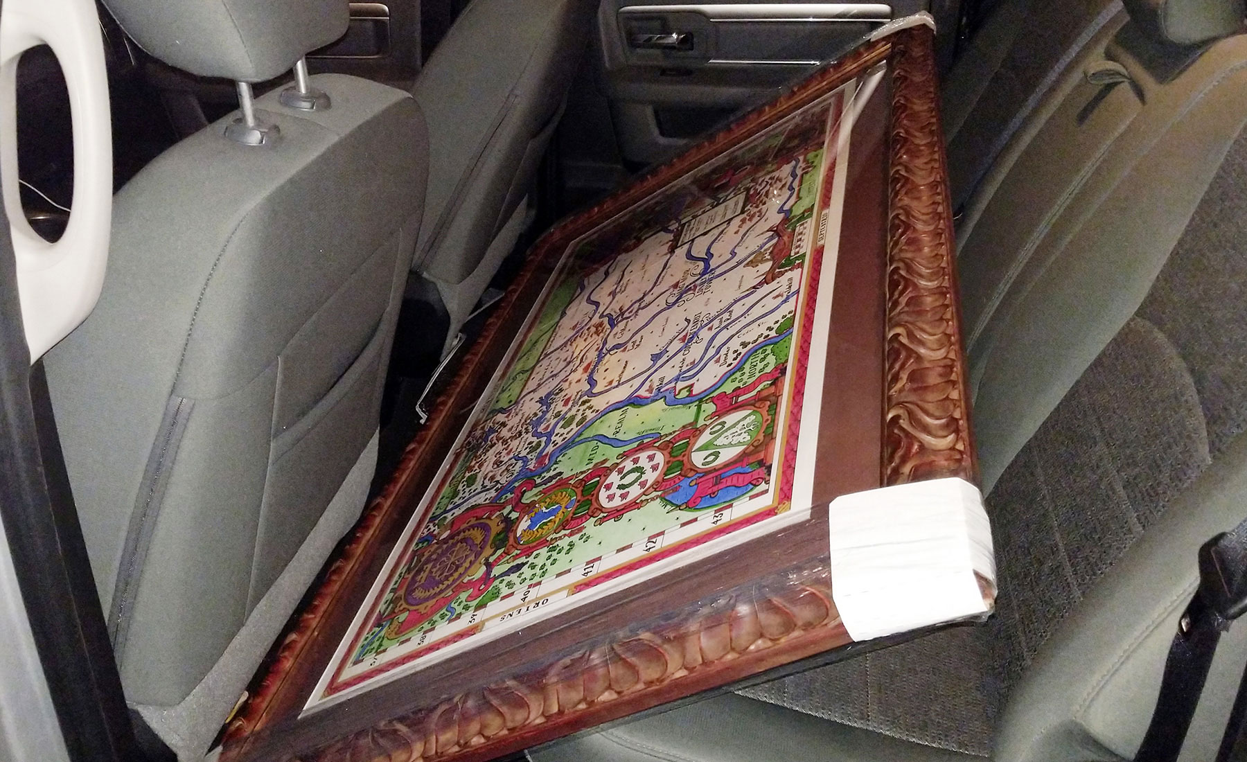 Fit of the framed map in the back row of the truck